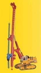 H0 Hydraulikbagger mit Bohrgerät, drehendem Bohrer und beleuchteten Frontscheinwerfern, Funktionsmodell